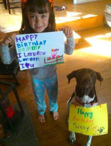 Sissy's Birthday - Mr. Buddy Bear has a message around his neck.